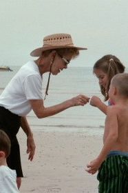 my mother teaching my children about shells at the beach.