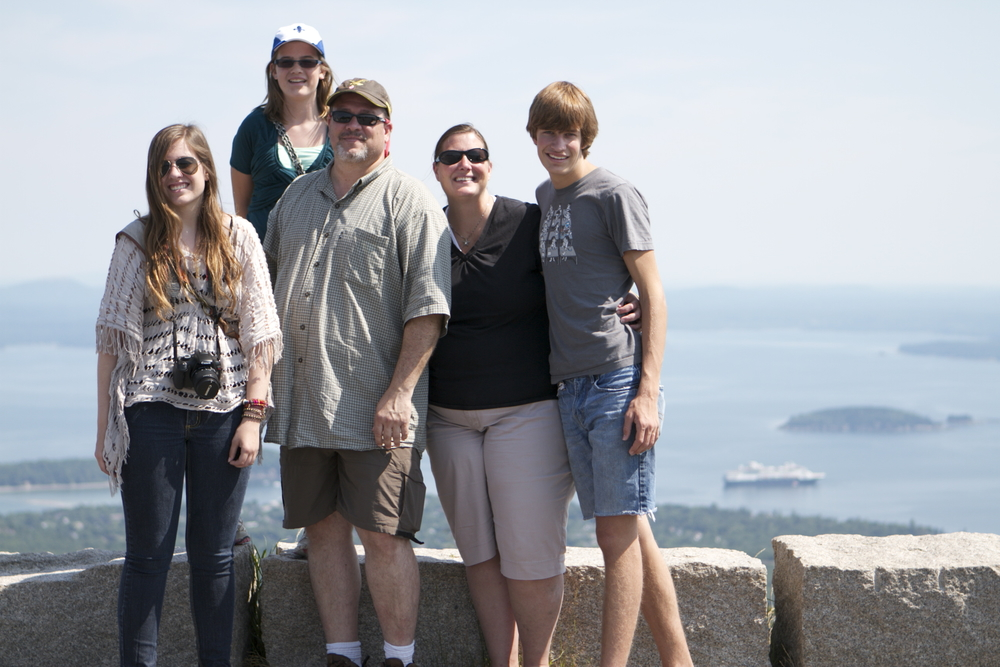 the marshall family on the top of cadillac mountain in arcadia national park, maine. you can just barely see our cruse ship, the maasdam (a holland america ship) in the distance.