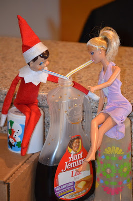 elf on a shelf drinking syrup.jpg