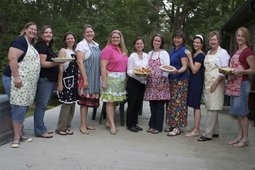 we had our book club meeting for the book THE HELP by kathryn stockett at my house. we all wore our favorite aprons and i made chocolate pie...