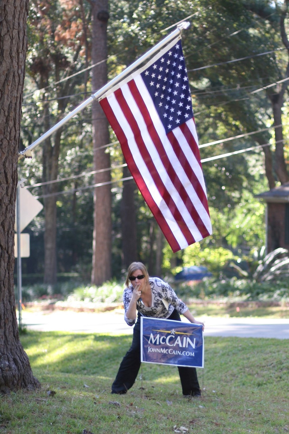 on election eve... my friend, liz, is trying to steal my mcCain sign.  where is the civility? she needs a muffin....