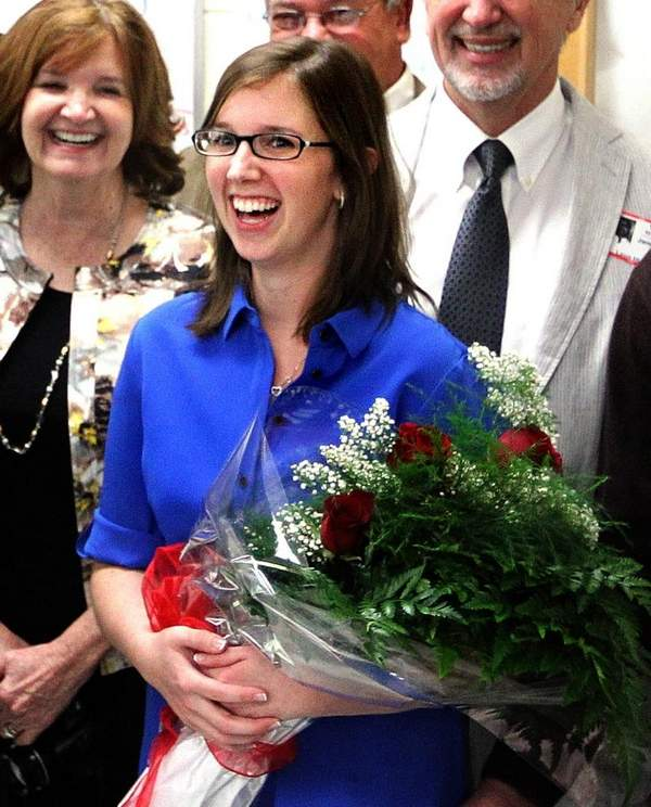 rebecca kirchharr finds out that she is the teacher of the year for our county. my favorite part of the photo is her mom right behind her. look at her mom's smile. her mother is also a teacher.
