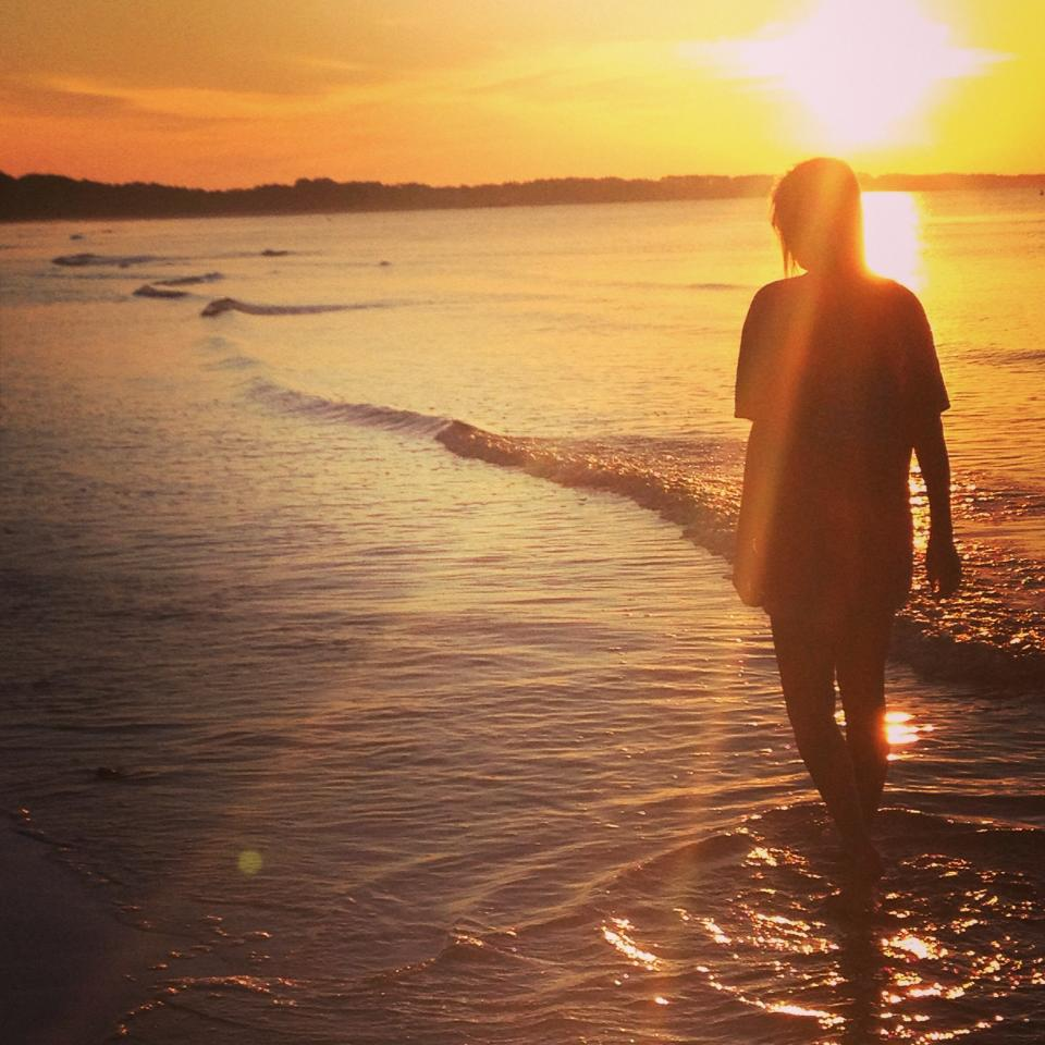 "our sweet new ole miss friend walking on ""price's beach"" at sunset. saying goodbye until we meet again..."