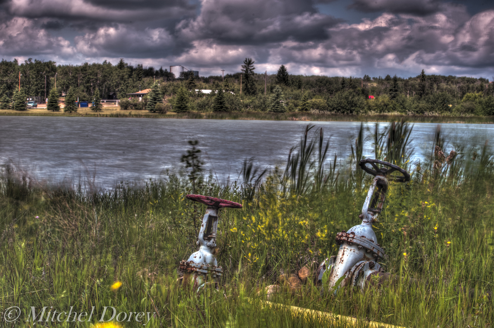 Hot and Cold! I'm not sure what these two valves were for but I'm sure they served their purpose at one time. This is an HDR and was shot with a Vari-ND filer at 5 frames. The filter has a built in warming polarizer which helped with the colour in the clouds.