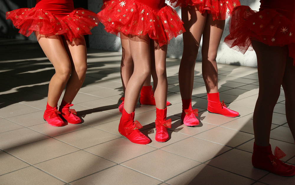 Young girls line up to dance during a holiday performance at the Quincy Mall.