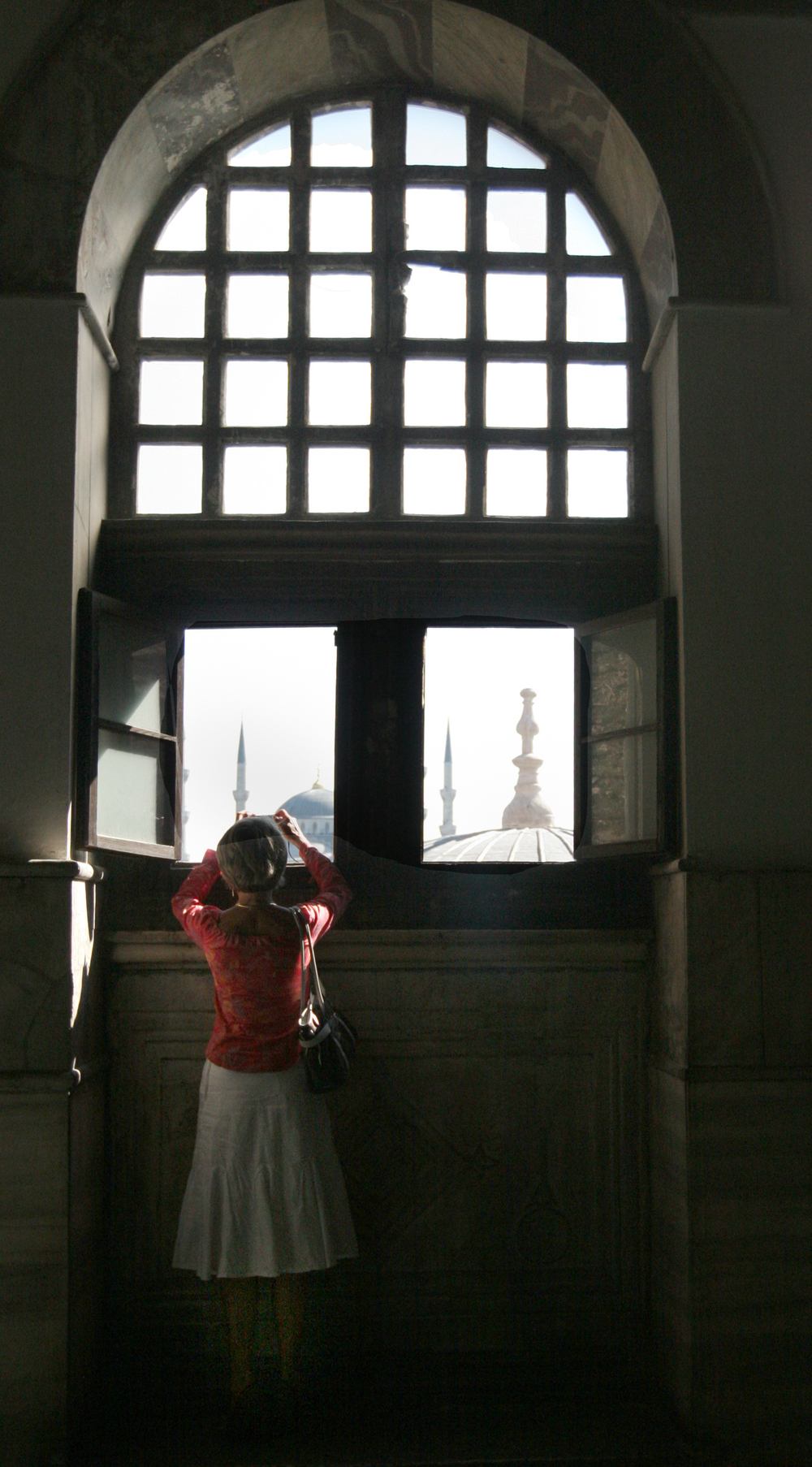 A tourist at the Hagia Sophia tries to get a photograph of downtown Istanbul's Sultanahmet district.
