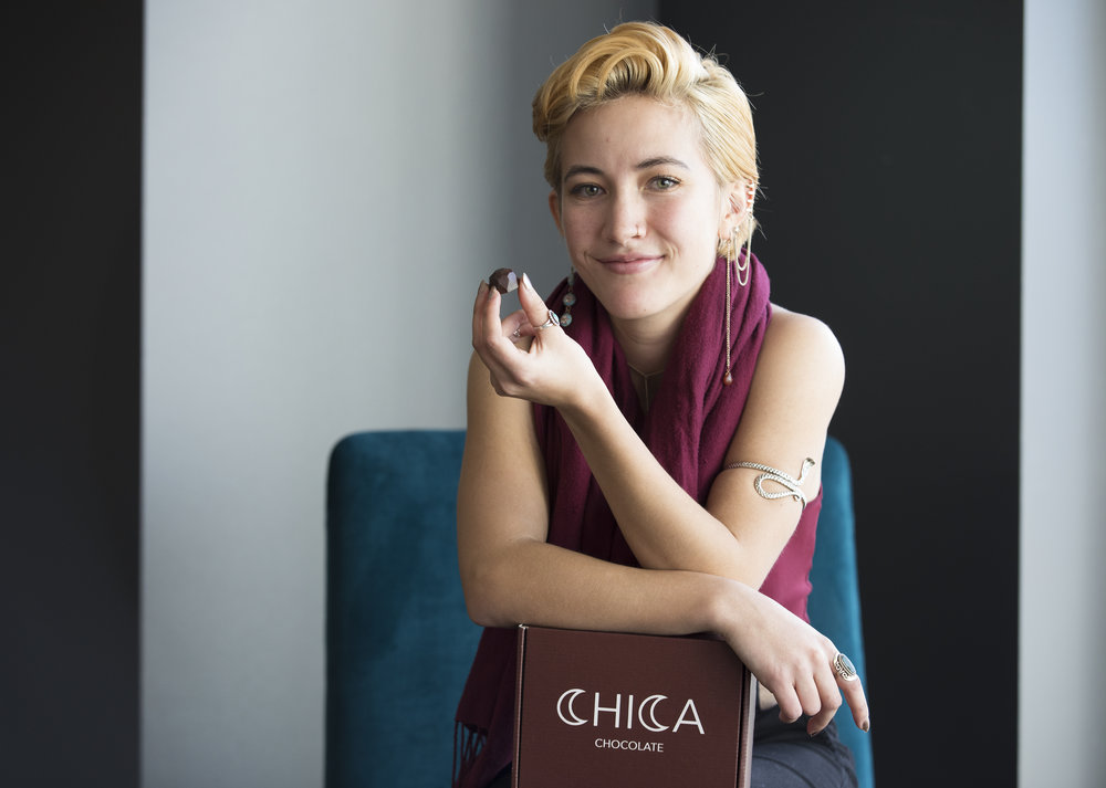 Cassidy Lam poses with one of her chocolates from the company she has started, Chica Chocolate. Lam hopes to revolutionize and help girls love their periods by selling them period soothing chocolates made from Chinese herbs.