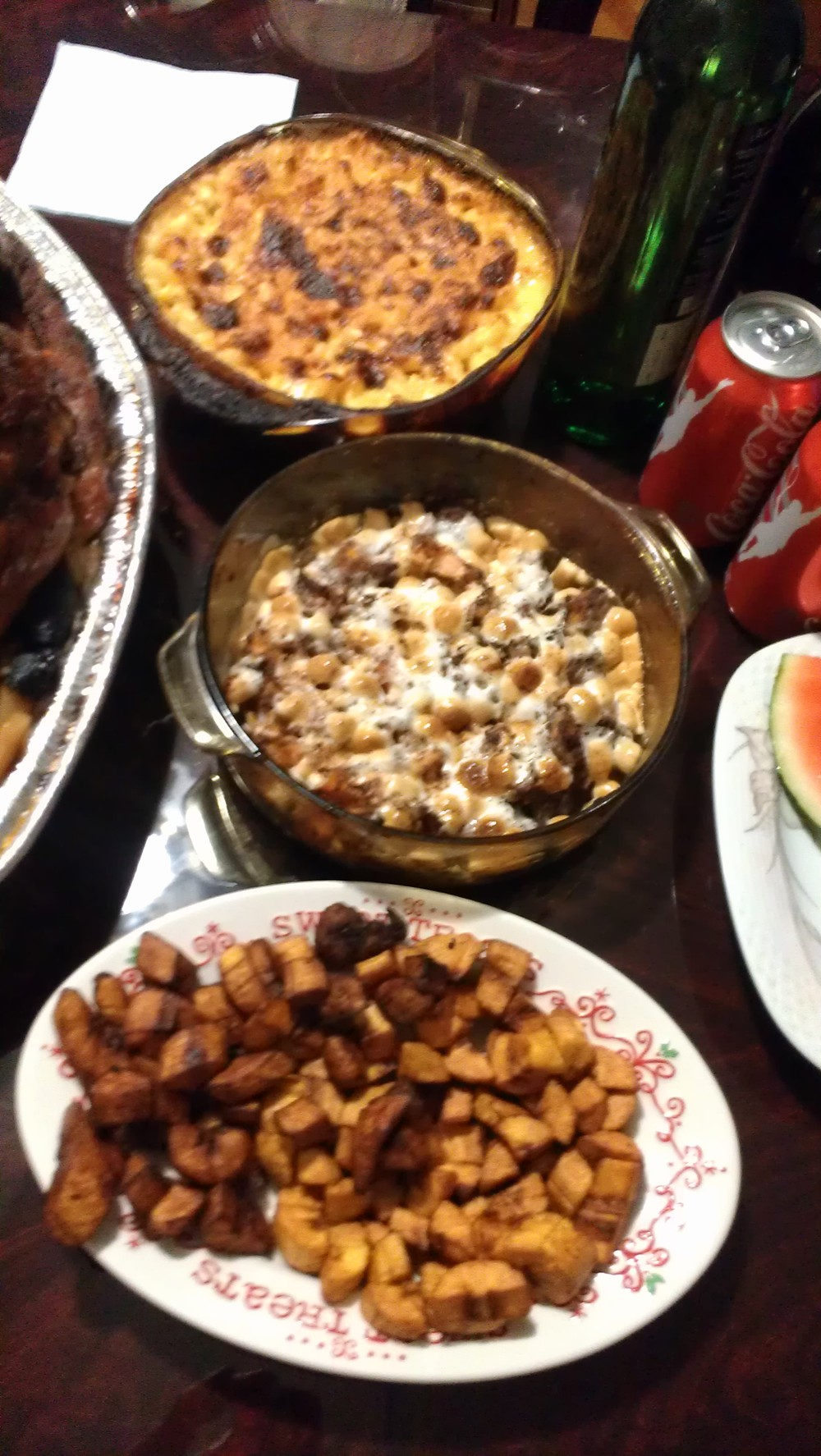 A trio of even more sides! From top to bottom - Mac & cheese, candied yams covered inmarshmallowsand fried plantains.