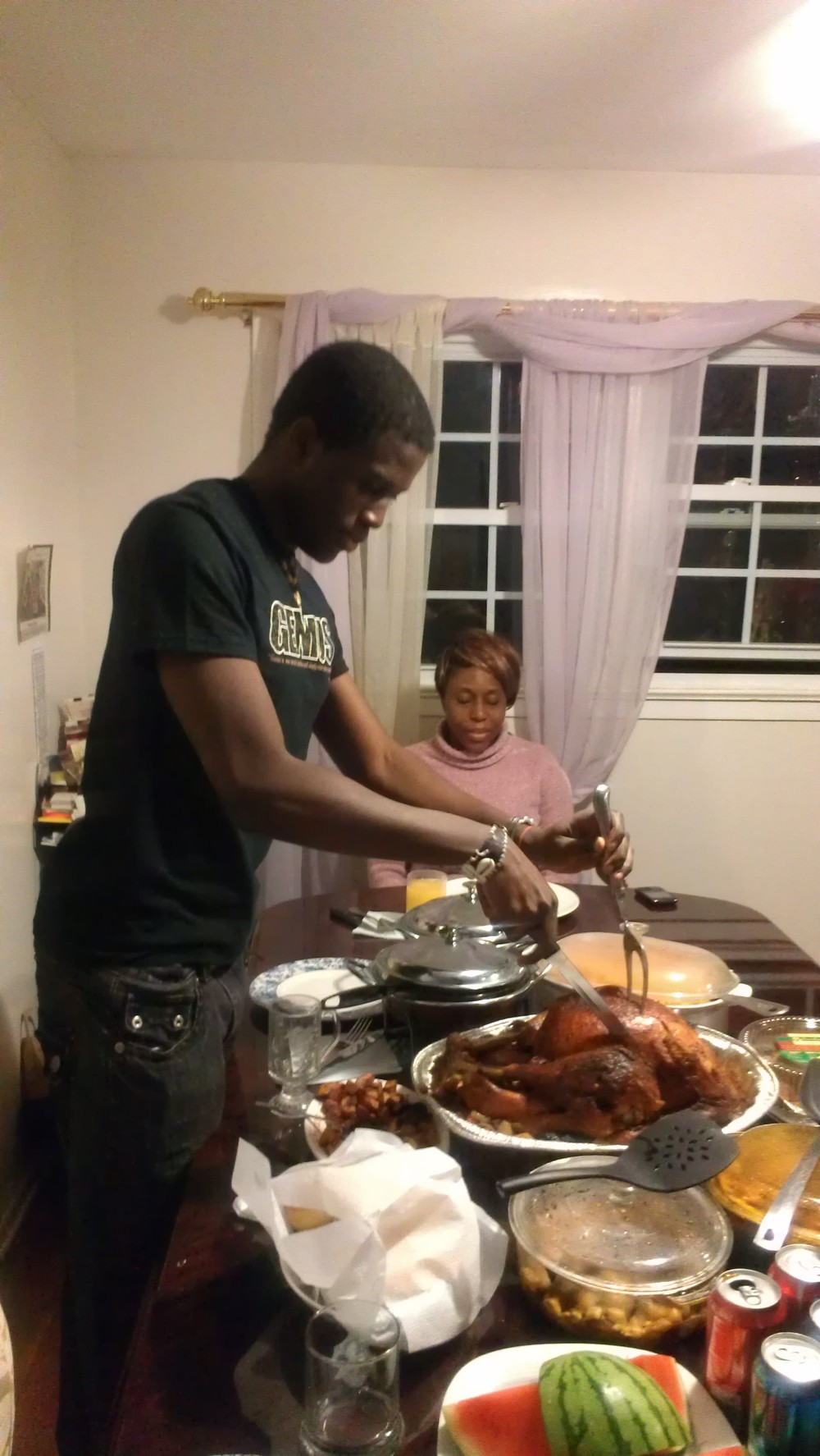 This year we had the youngest - Fola carve the turkey!! ....and yes, he is also bigger than me, both of my younger siblings are....its crazy! LOL