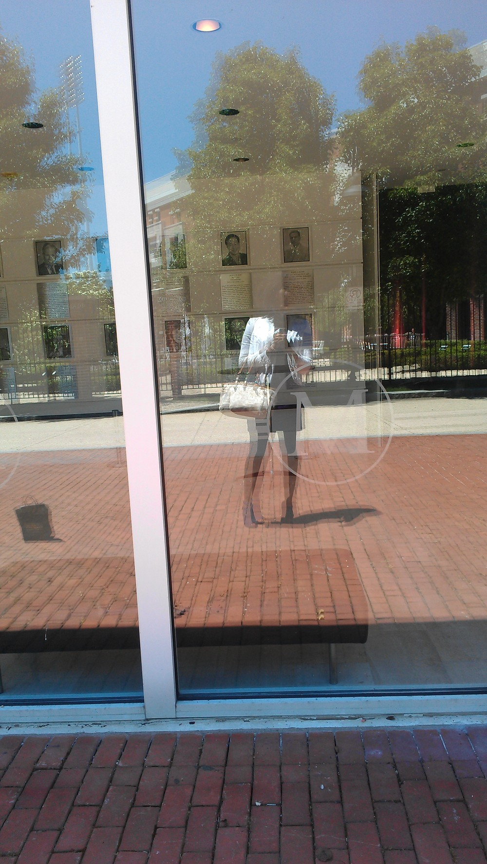 Touchdown on UMD's campus, of course in my signature brand colors (purple dress and white blazer). Here's a cool pic I took in the window