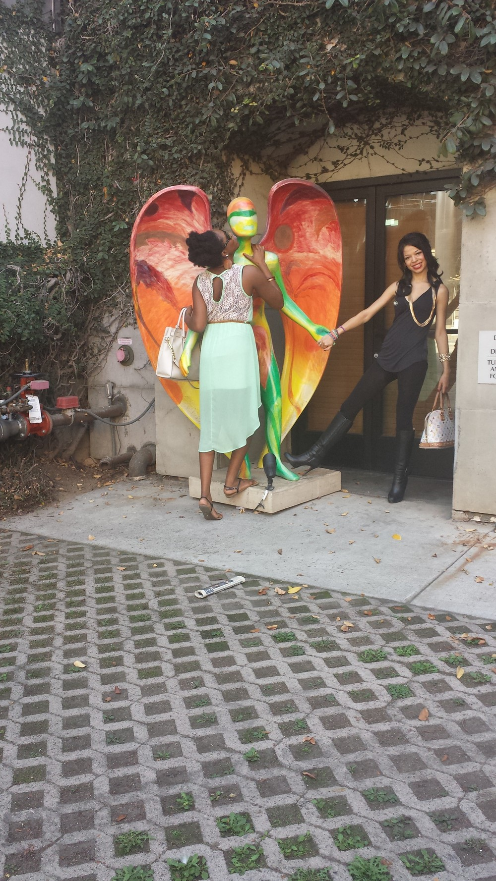 Kissing a rainbow statue :) It happens