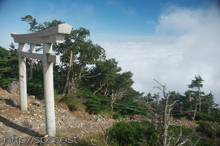 a gate above the clouds of Nantai Mountain