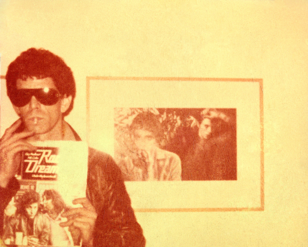 This 1974 photograph of Lou Reed posing in front of his portrait —now owned by David Bowie—and holding a copy of the first US edition of  Rock Dreams  was one of Peellaert's cherished possessions.