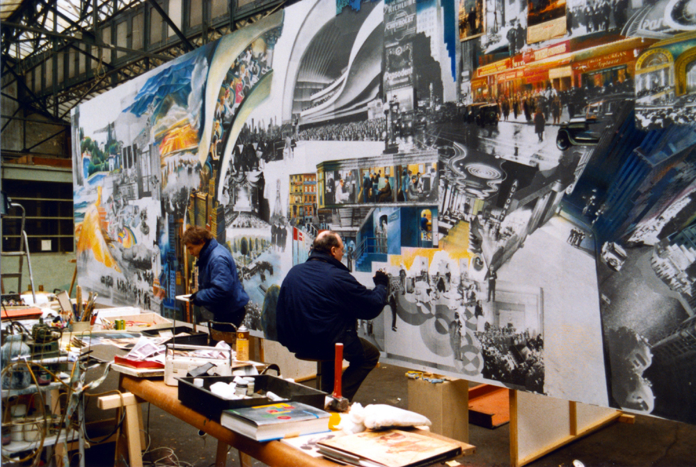 Guy Peellaert (right) in his Paris studio, at work on the Gershwin Frieze with an assistant in 1991.