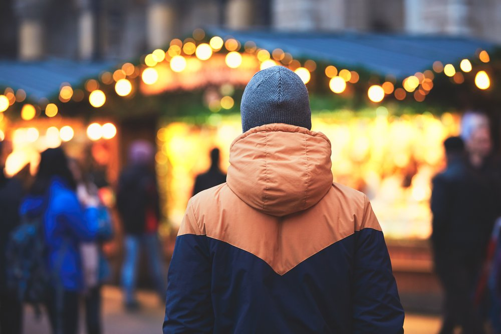 man-in-christmas-market-PCNAV69.jpg