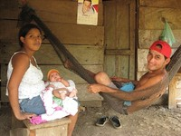Antonio and his wife with their new baby in Darien, Panama