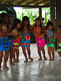 Indigenous girls in Arimae perform a traditional dance