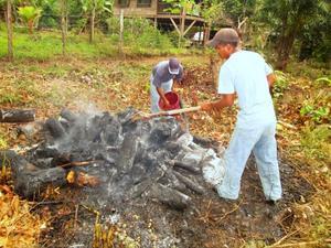 Photo of Planting Empowerment employees making biochar