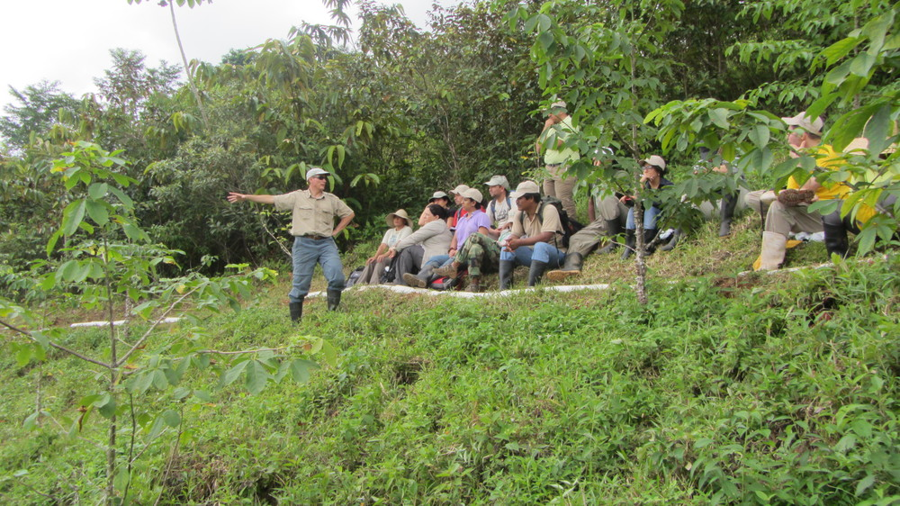 Dr. Jefferson Hall explaining the different native species tree planting treatments in abandoned cattle pasture land during an ELTI forest restoration course in the Smithsonian's Agua Salud Project site (August 2013).   Photo courtesy Saskia Santamaria.