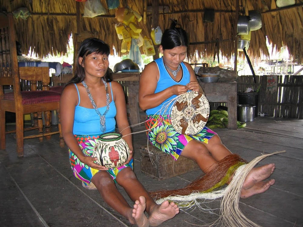Embera women weave baskets in Arimae