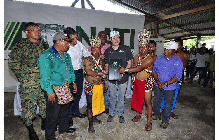 Arimae receives its land title during a ceremony in the community. Photo courtesy of  El Siglo .