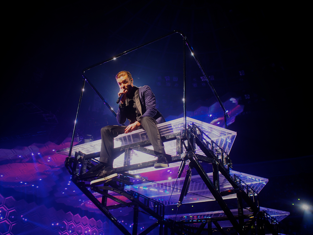 Timberlake taking it to the crowd on his movable stage. (Photo Credit: Robert Castro)