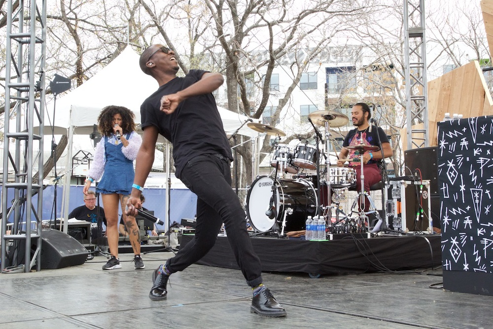 Buraka Som Sistema encouraging a impromptu mid-day dance party (Photo Credit: Robert Castro)
