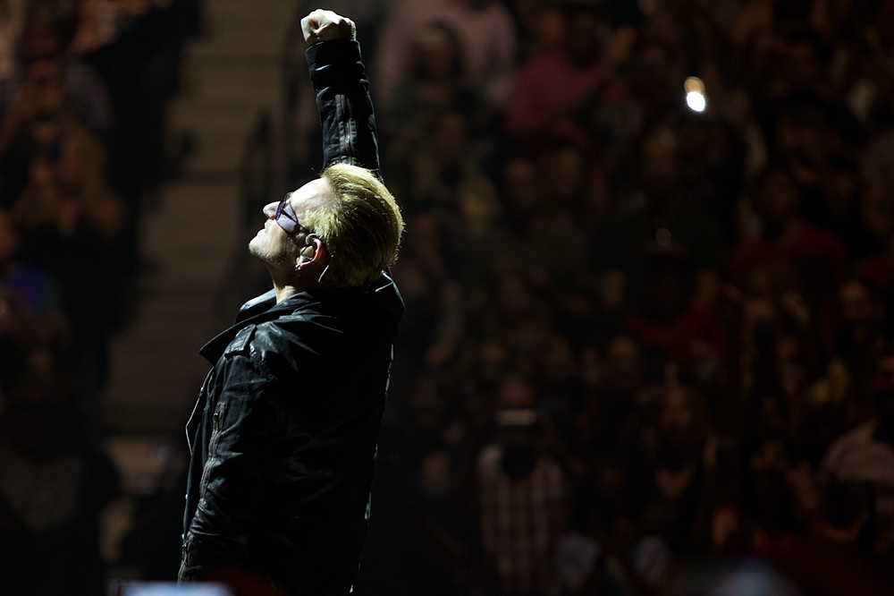 Bono raising one of many fists he had for us throughout the night. (Photo Credit: Robert Castro)