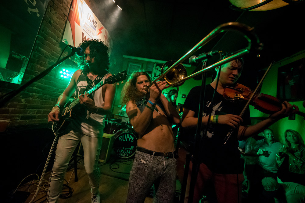 Members of iZCALLi giving us a dose of rock and roll. (Photo Credit: Andrew Rios)