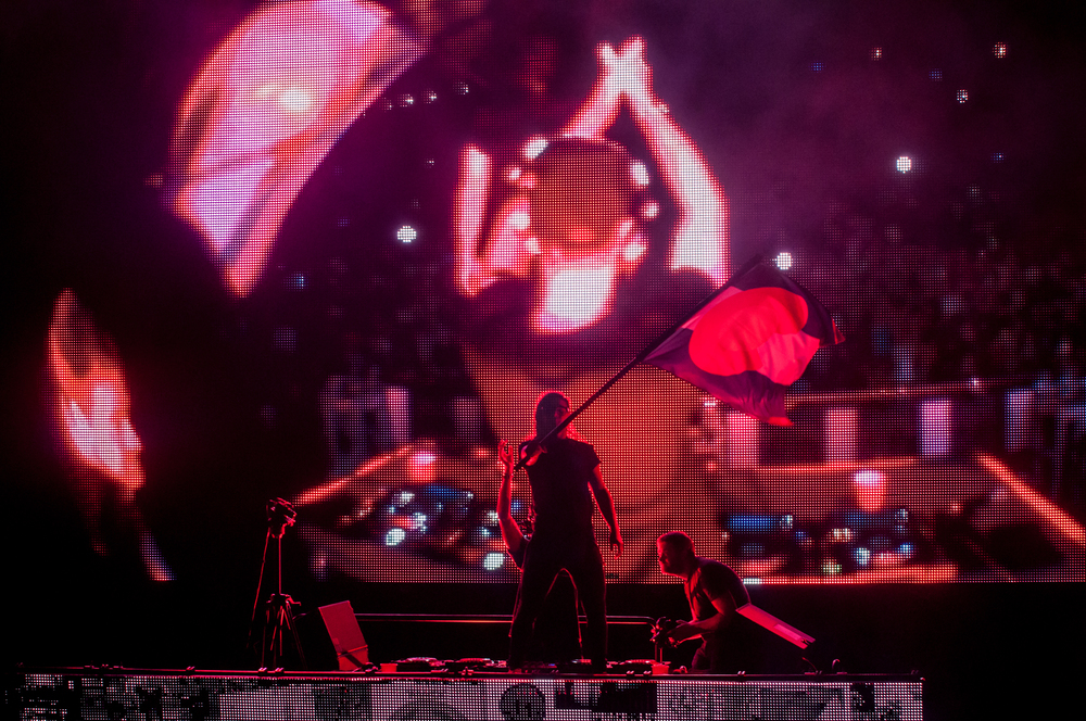 Skrillex waving the Colorado flag (Photo Credit: Andrew Rios)