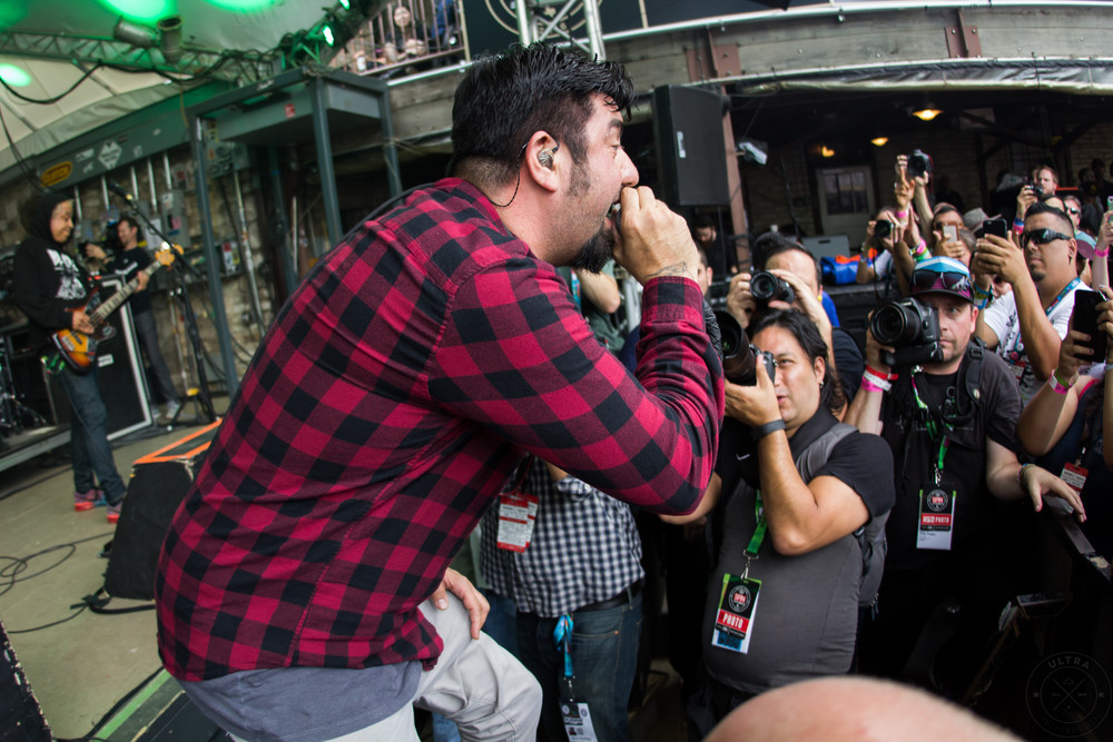 Chino Moreno of Deftones takingit to the crowd (Photo Credit: Robert Castro)