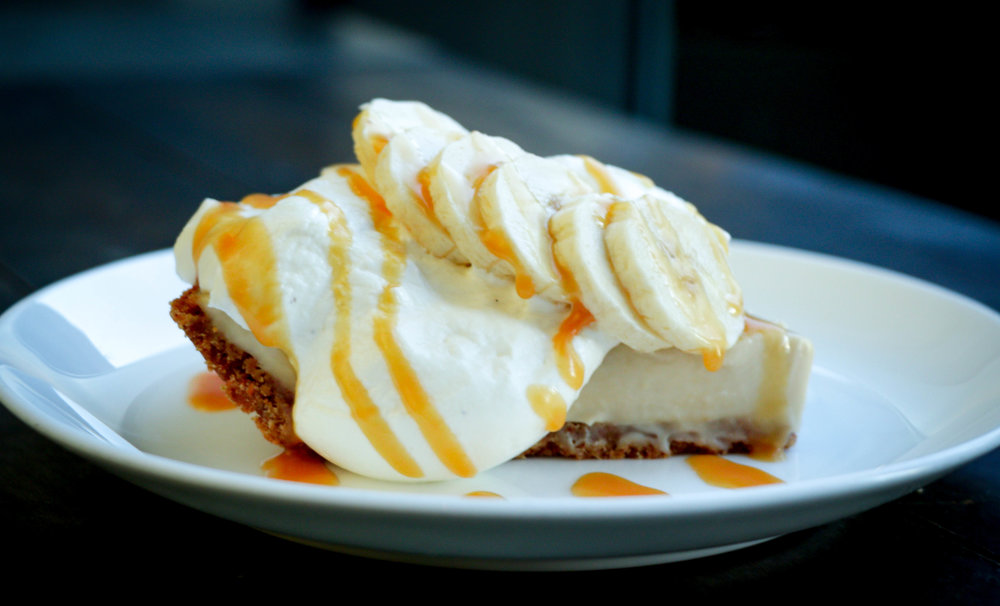 Banana cream pie (FNG) - fresh banana custard, graham cracker crust, whipped cream, fresh banana slices and salted caramel.