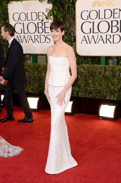 Anne Hathaway reminds me so much of Audrey Hepburn. Dress by Chanel