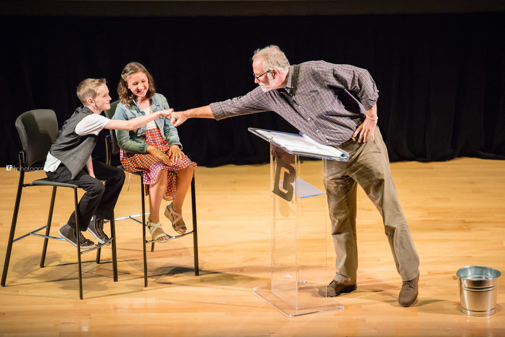 "Bob Goff ""fist-bumping"" two amazing kids during The Hope Event!"