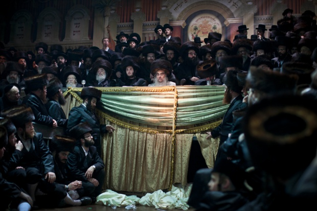 Ultra-orthodox Jews gather for the traditional Jewish wedding for Chananya Yom Tov Lipa, in the Israeli town of Petah Tikva near Tel Aviv, Israel. Photograph: Oded Balilty/AP