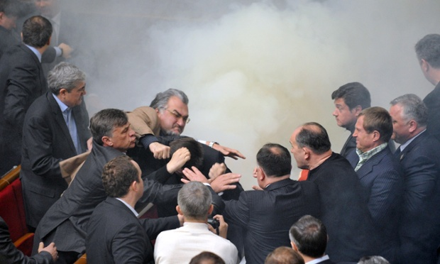 Deputies of Ukraine's parliament fight among smoke grenades thrown during a session in Kiev, 2010. Photograph: Sergei Supinsky/AFP/Getty Images