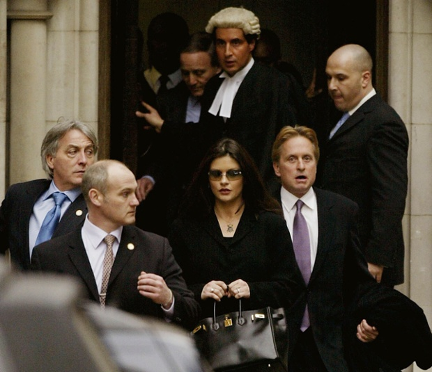 In 2003, Catherine Zeta-Jones and Michael Douglas leave the Royal Courts of Justice in London after suing Hello! magazine for millions of pounds after it published unauthorised photos of their New York wedding, for which they had signed an exclusive deal with rival magazine OK. Photograph: Scott Barbour/Getty Images