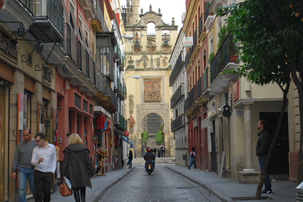 A street in Seville. If you add up the sidewalk space, it's almost as wide, if not as wide, as the space dedicated to cars and motorcycles. But this understates the pedestrian-friendliness of Seville because people feel very comfortable walking on the roads in Seville, not just the sidewalks.
