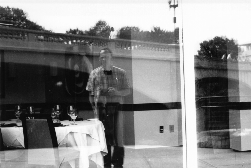 This is my tribute to Vivian Maier. She did a lot of self-portraits, similar to this.  Much of her photography played with reflection and layers.  She did some really amazing work, actually.