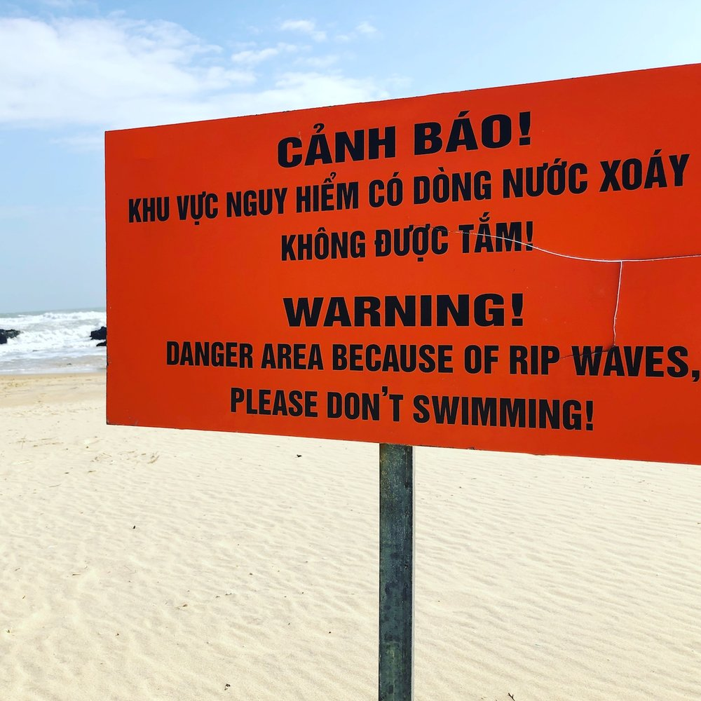 "Insight: ""Swimming"" is the wrong verb tense.   Outsight: The waves behind this sign could kill you. RIP."