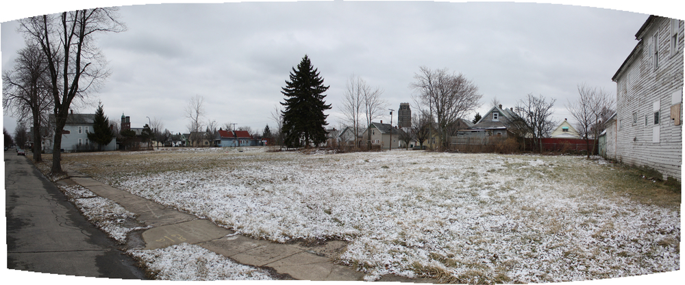 Current Condition:  Lots on Gibson Street currently sit unutilized and are visibly connected to continuous lots in the adjacent blocks. These vast, unwelcoming plots of land dominate the streetscape.