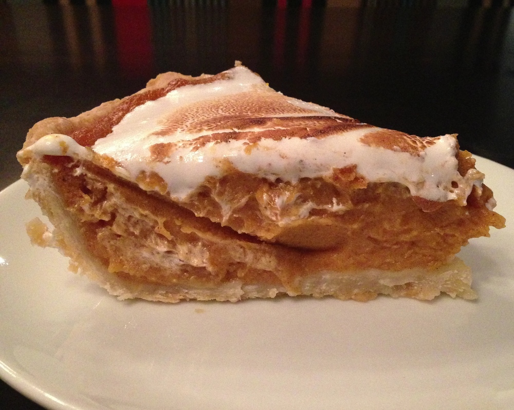 Bourbon Sweet Potato Pie - sweet potato and bulleit bourbon filling in a homemade pie crust, topped with bruleed meringue.