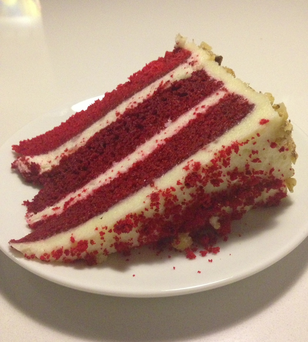 Nana's Red Velvet - three layer red velvet cake with buttercream roasting and toasted walnuts.