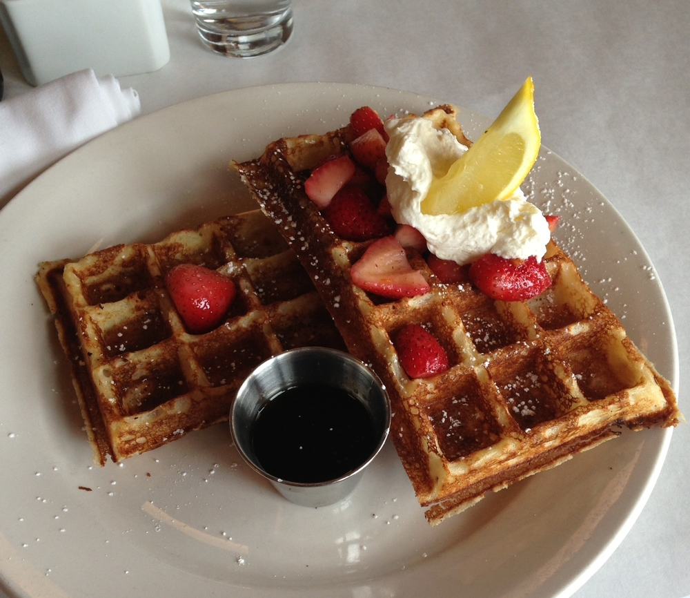 Belgian waffle with macerated strawberries, creme fraiche and pure maple syrup.