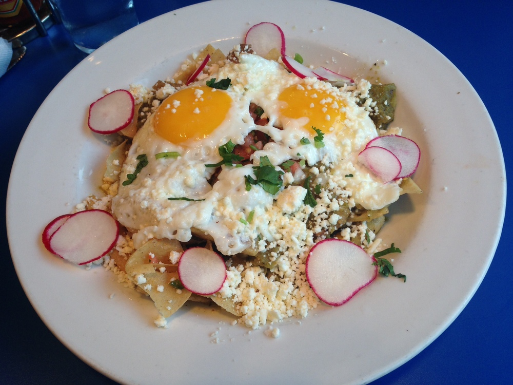 Monty's Blue Plate Diner  - Berkshire pork simmered in a tomatillo chili verde, served over crispy corn tortillas; with two eggs, pico de gallo, and feta cheese.