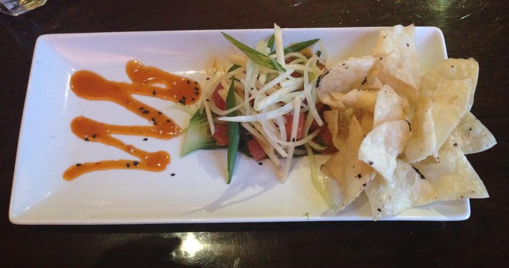 Tuna Poke - sashimi grade ahi tuna with seaweed salad and apple cucumber slaw with homemade fried wonton chips