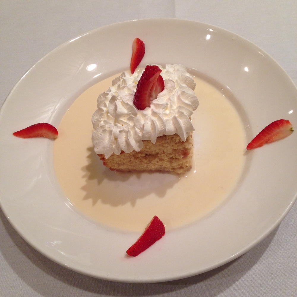 Tres Leches Cake - sponge cake covered with three milks, touch of pisco and topped with chantilly cream.