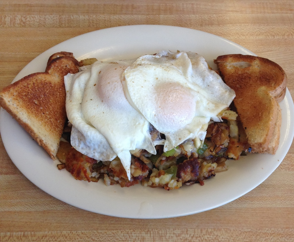 Fair Oak Skillet - fried potatoes, sausage, green peppers, onion, mushrooms, and swiss cheese,