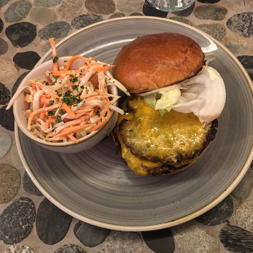 Veggie Burger, brioche, cheddar, tomato jam, onion, mustard-aioli,carrot-kohlrabi slaw