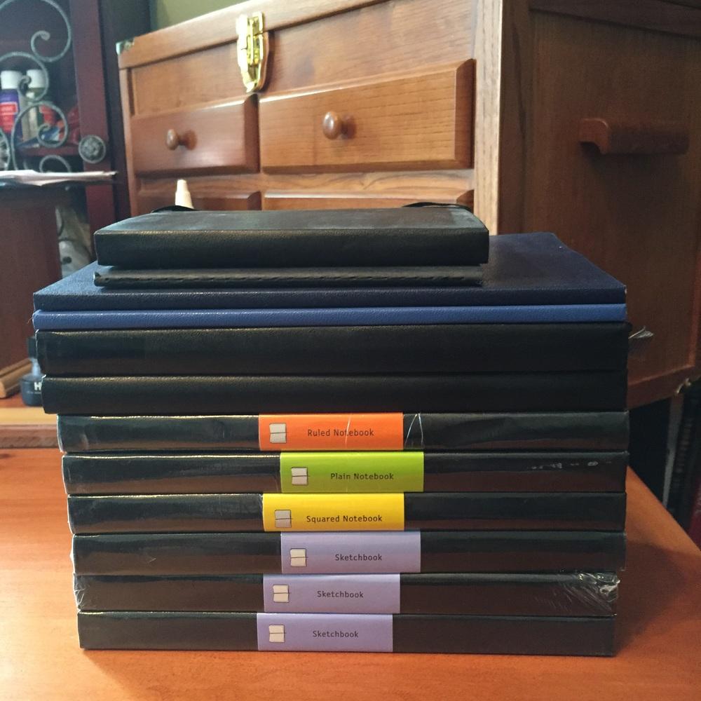 Giant stack of Moleskine notebooks